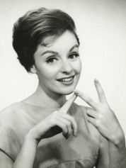 george-marks-young-woman-counting-on-fingers-posing-in-studio