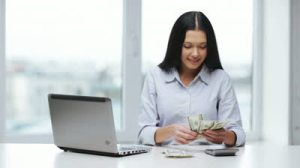 stock-footage-business-and-profit-concept-woman-with-calculator-counting-us-dollar-money