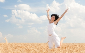 happy-woman-jumping-in-golden-wheat