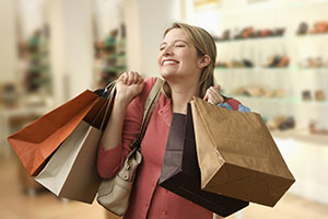 woman-holding-shopping-bags-379936