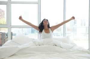 woman-waking-up-motivated-lwadann-tardif-getty