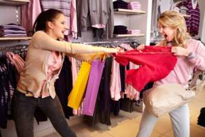 Women-Fighting-Over-Clothes-on-Black-Friday